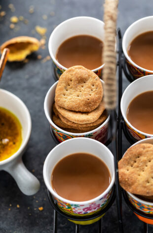 mathris arranged with glasses of chai in a glass holder