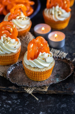 cupcakes topped with jalebi and tealights placed in the background